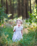 Beautiful girl walking in a sunny autumn park Royalty Free Stock Photo