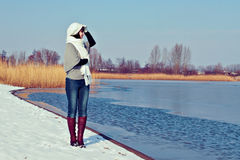 Beautiful girl walking at winter lake Royalty Free Stock Images