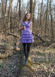 Beautiful girl walking in the woods with a bouquet of snowdrops Royalty Free Stock Photos