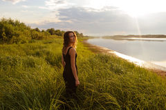 Beautiful girl walks in high grass Stock Images