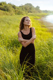 Beautiful girl walks in high grass Royalty Free Stock Photo