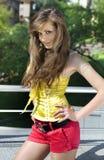 Beautiful girl walks in park stock photo