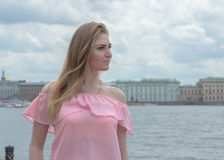 A beautiful girl walks by the river. Royalty Free Stock Photography