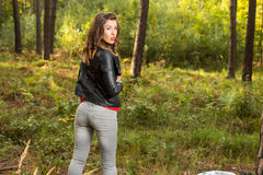Beautiful girl walks in the woods Stock Images