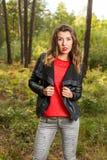 Beautiful girl walks in the woods Stock Photos