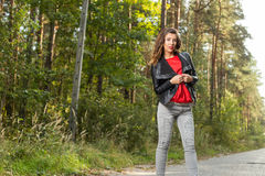 Beautiful girl walks in the woods Royalty Free Stock Photography
