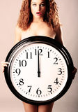 Beautiful girl with a wall clock Stock Photos