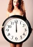 Beautiful girl with a wall clock Stock Photos