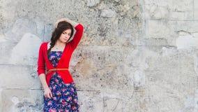 Beautiful girl at the wall Stock Image