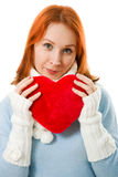 Beautiful girl in warm clothes with a heart Royalty Free Stock Photography
