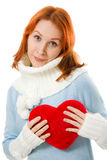 Beautiful girl in warm clothes with a heart Royalty Free Stock Photo
