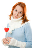 Beautiful girl in warm clothes with a heart Royalty Free Stock Photos