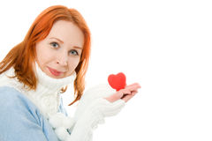 Beautiful girl in warm clothes with a heart Royalty Free Stock Image