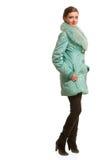 Beautiful girl in warm fur coat with fur Stock Photos
