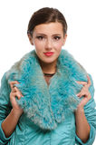 Beautiful girl in warm fur coat with fur Stock Photo