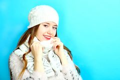 Girl in a warm scarf and a cap Royalty Free Stock Image