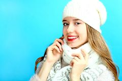 Girl in a warm scarf and a cap Stock Images