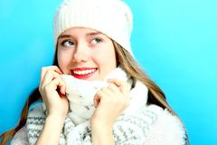 Girl in a warm scarf and a cap Stock Image