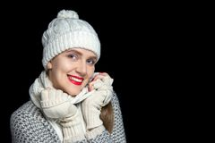 Beautiful girl in a warm set of scarf, hat and gloves royalty free stock photos