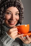 Beautiful girl in warm wool hat drinking tea Stock Photos