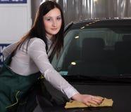Beautiful girl wash cars Stock Image