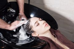 Free Beautiful Girl Washes Her Hair Before A Haircut In A Beauty Salon. Hair Washing At A Hairdressing, Young Caucasian Girl Royalty Free Stock Photo - 109574415