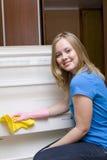 Beautiful girl washes refrigerator Royalty Free Stock Image