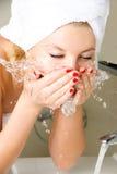 Beautiful girl washing her face Stock Photos