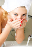 Beautiful girl washing her face Stock Images