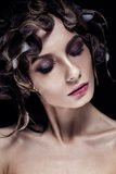 Beautiful girl with wat hairstyle and bright makeup. Beauty face. Photo was made in studio Stock Photography