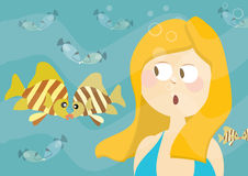 Beautiful girl watching kissing fishes Royalty Free Stock Images
