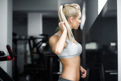 Beautiful girl watching in mirron in the gym Royalty Free Stock Photography