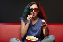 Beautiful girl watching movie with 3d glasses Royalty Free Stock Photos