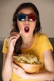 Beautiful girl watching movie Stock Image