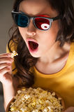 Beautiful girl watching movie Stock Photography