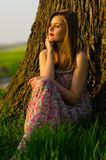 Beautiful girl watching sunset Royalty Free Stock Photos