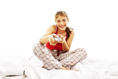 Beautiful girl watching tv on the bed Royalty Free Stock Photo