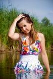 Beautiful girl in water Stock Image