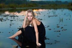 Beautiful girl  in water Stock Photos