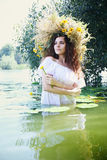 Beautiful girl with water lily Stock Photography