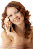 Beautiful girl in water with seashell. Royalty Free Stock Photography