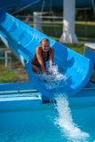 Beautiful girl on water slide at water park in Summer holiday from Hungary royalty free stock photo