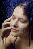Beautiful girl in the water and spray Stock Photography