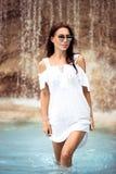 Beautiful girl in the waterfall Stock Image