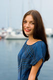 Beautiful girl on the waterfront Royalty Free Stock Photos