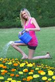 Beautiful Girl Watering Flowers Royalty Free Stock Images