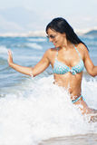 Beautiful girl in wave surf Royalty Free Stock Image
