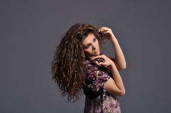 Beautiful girl with wealth of wavy brown hair Royalty Free Stock Images