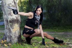 Beautiful girl with weapon Stock Images