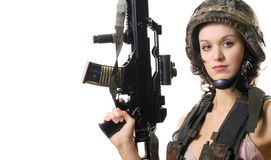 The beautiful girl with the weapon royalty free stock image